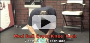 med ball cross knee tuck exercise