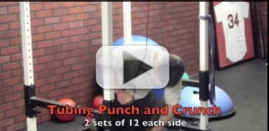 tubing punch and crunch exercise