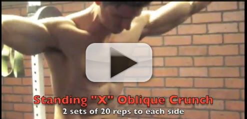standing x oblique crunch exercise