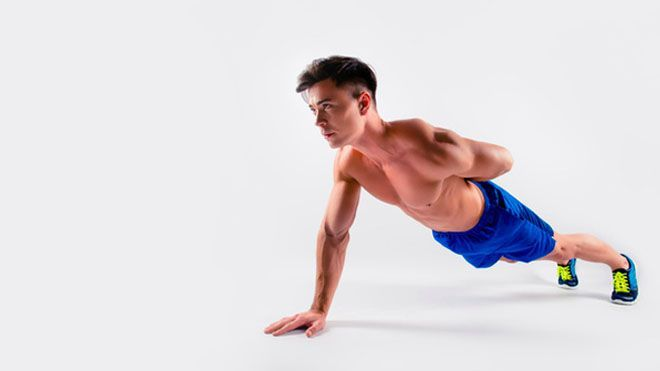 HOW TO DO A ONE ARM PUSHUP – AND BUILD A BIGGER CHEST IN THE PROCESS
