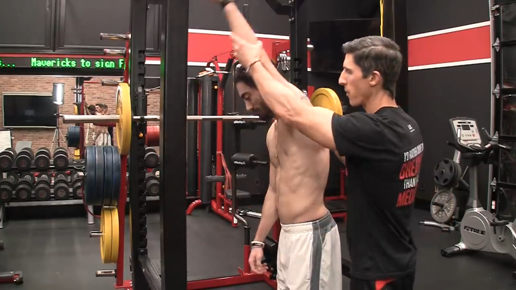 you can't lift your arm over your head with a rounded thoracic spine