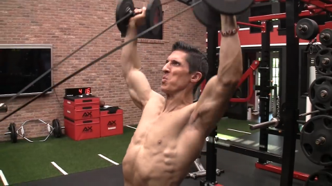 banded overhead dumbbell press