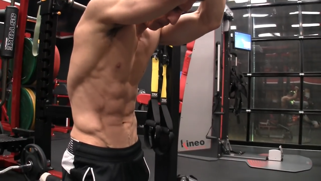 brace your abs before the banded pull down exercise