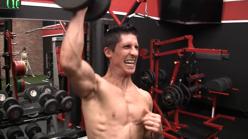 cheat lateral into dumbbell push press shoulder exercise