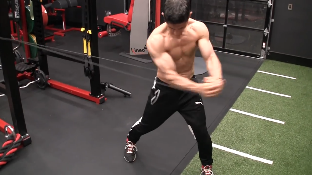 foot pivots on sledgehammer swing abs exercise