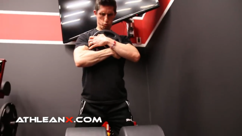 glute ham raise with weight plate