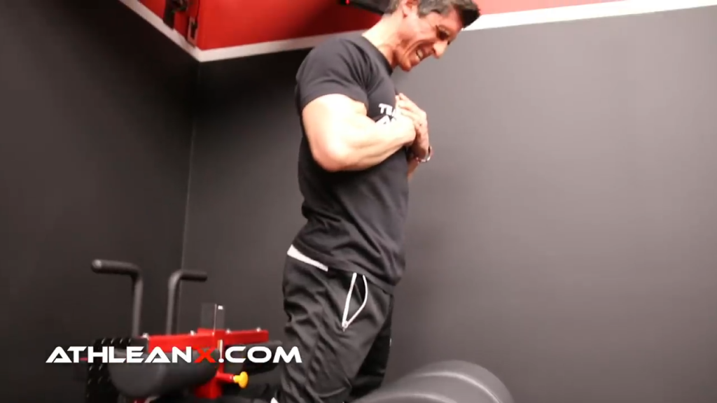 squeeze glutes at top of glute ham raise