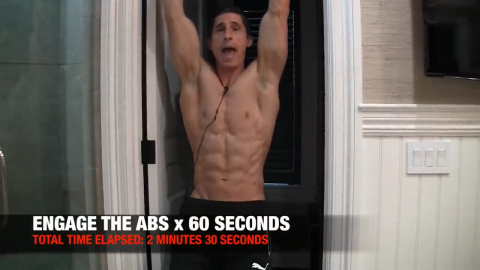perform this hanging abs exercise for 60 seconds every morning to engage the abs