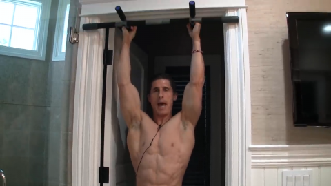 pull down the shoulder blades in the hanging abs exercise to reinforce scapular stability