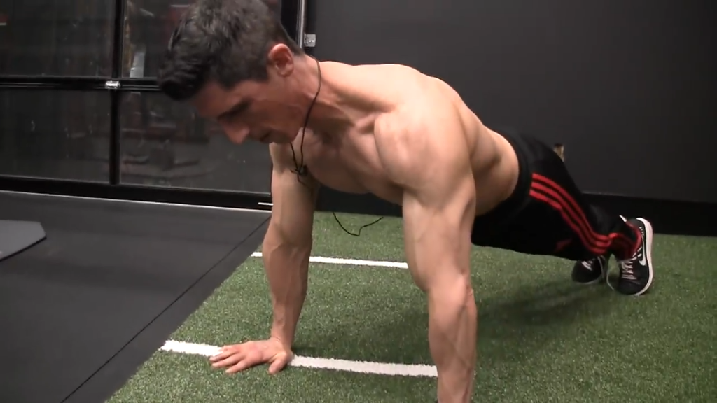 full lockout of the elbows is the correct top position for the pushup