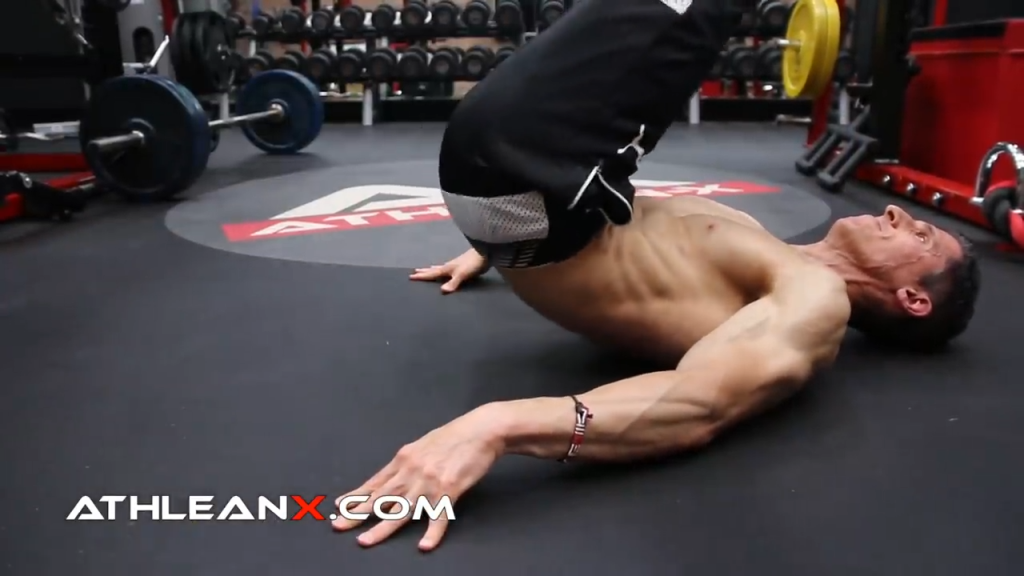 lift your pelvis off the ground in the reverse crunch