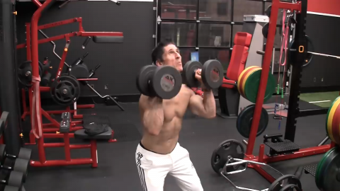 bend your knees and load the hips in the dumbbell push press for shoulders