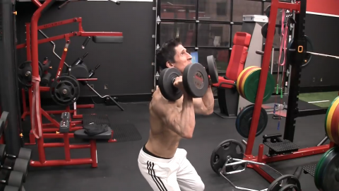 stick out your rear and perform a hip hinge in the dumbbell push press shoulder exercise