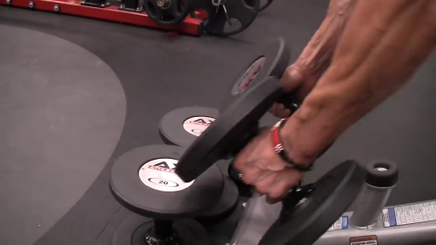 a set of dumbbells is placed on the ground for dumbbell touch rows