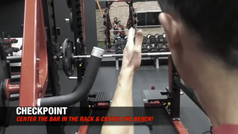 center the bar in the rack bench press